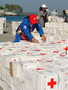 Colombian Red Cross volunteers help to unload relief items for in Port-au-Prince, Haiti.