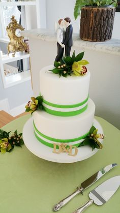 A modern cake for a modern day couple. Cake and photo provided by Pastry Chik. Flowers by Seasonal Celebrations.