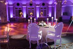 Color-changing LED uplighting, dark amber dance floor wash, and pin spotting of the centerpieces & wedding cake for a wedding at the Ritz Carlton in Philadelphia. Photo by Asya Photography. Lighting by Synergetic Sound + Lighting: www.sslproductions.com