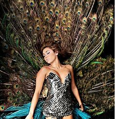 Miley Cyrus Gives Us The Bird In A $25,000 Peacock Corset Dress