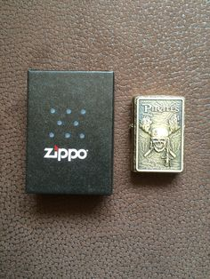 Original Zippo: Brass Gold Custom Made: A brass Plate with Pirate Emblem, different kinds of Paint