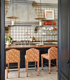 Eclectic kitchen with patterned tile backsplash and stools