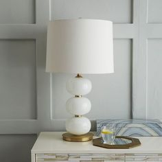 Abacus Table Lamp - Milk White. Love the milk white and brass. Adds warmth but very versatile.
