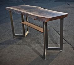 Live edge walnut high table with walnut shelf on steel legs hip hop metal legs walnut live edge natural edge bar