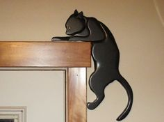 Handmade Intarsia black cat, animal art, wooden door topper Halloween home decor. via Etsy