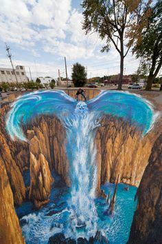 Edgar Muller, who is probably the third most popular 3D street artist (Kurt Wenner and Julian Beever are 1st and 2nd) created this amazing picture in Michigan, USA. Titled 'Phoenix' by Muller. The picture was created for the City Art Gallery in August 2011 and drew crowds of people over a week who posed for photographs with the artwork.