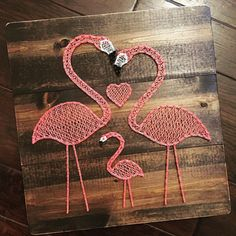 Pink Flamingo string art, approximatley 17 tall x 17 wide. Wood will be stained dark walnut and will be distressed along the edges. Please contact us for free local pickup.