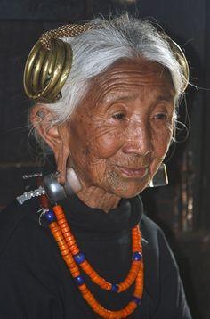 MYTHODEA — India ~ Nagaland, Elderly Ao Naga woman, at...