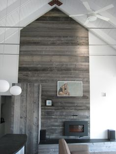 I like it. It's a fireplace/mantle but not in the obvious way. Much better than the big bulky brick ones. Reclaimed Wood Wooden Wall Panels, Wood Panel Walls, Wooden Walls, Wood Paneling, Wall Panelling, Plank Walls, Wood Flooring, Wood Planks, Wood Fireplace Surrounds