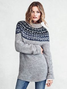 Gray sweater in wool blend, with stand-up collar and blue & black jacquard-knit pattern at neck. | Warm in H&M