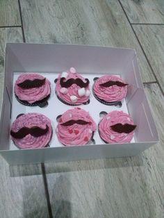mustache cupcakes with raspberry cream