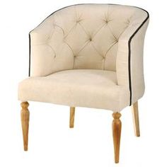 """Diamond-tufted accent chair with turned legs.  Product: ChairConstruction Material: Fabric and woodColor: BeigeFeatures: Exposed turned legsDimensions: 32.5"""" H x 25"""" W x 24"""" D"""