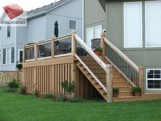 This mid height elevated deck works perfectly wtih the sloping grade and has a well built enclosure below it.