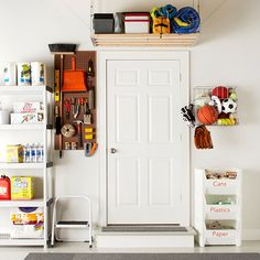 A garage is an optimal place to organize and store not only garage gear but also off-season belongings. This space recruits a variety of storage options, such as a freestanding shelving unit to hold things like cleaning supplies and dog food and a pegboard for tools to maintain a sense of order. A wooden shelf was installed over the door to tuck away seasonal supplies