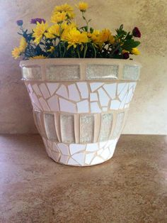 A personal favorite from my Etsy shop https://www.etsy.com/listing/471563352/large-flower-pot-rustic-mosaic-planter