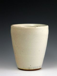 Fantastic white linen glaze with unfinished bottom. I would like to see a slightly less tapered shape.