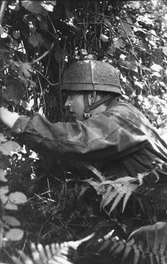 A German paratrooper in the Bocage area of France, 1944.