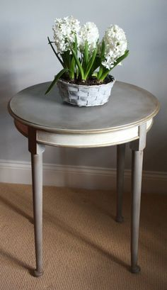 Occasional table painted in French Linen & Old White with Gold gilding wax detail. £125.00 at Sally White Designs found on facebook.