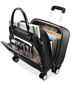 Luck for a lady. Sitting pretty on four multi-directional spinner wheels, this mobile office packs in everything you need & want for quick overnight & day trips. A padded laptop compartment, padded ac