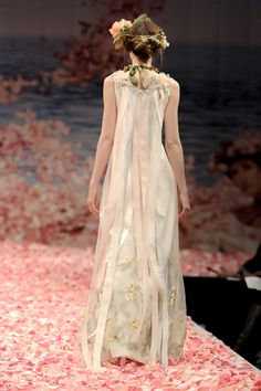 """Claire Pettibone """"Aria"""" wedding down, Spring 2013, iridescent green embroidery over lace with pastel ribbons streaming from the embellished  back; also available with Ivory/Silver embroidery"""