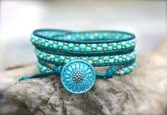 This beautiful triple leather wrap bracelet is made with a mix of beautiful aqua blue crystals and bronze seed beads on matte teal leather cord. Gorgeous aqua blue glass sunflower button and three loop adjustable closure. Each unique leather wrap bracelet is handmade by me. I only make