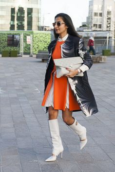 Pulling off a 60's vibe in a white and orange dress and cut out boots. #LFW