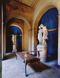 """Potsdam, Sanssouci, Apodyterium (Roman Baths) (by HEN-Magonza) The open-top patio, the Impluvium is completed at the rear by the apodyterium, a rectangular training and dressing room. The marble sculptures are """"a boy and girl at the well"""" by JW Henschel and the """"Bacchante"""", from the first half of the 19th Century ."""