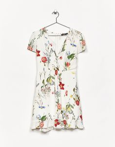 Strappy ruffled dress with a floral print. Discover this and many more items in Bershka with new products every week