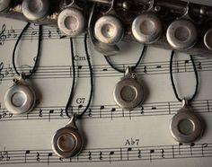 Silver recycled flute keys made into pendants