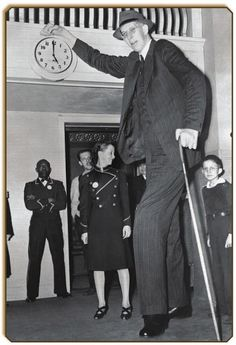 Photos of Robert Wadlow - The Tallest Person in History Robert Pershing Wadlow (1918 – 1940) is the tallest person in history for whom there is irrefutable evidence. Wadlow is sometimes known as the Alton Giant or Giant of Illinois because he was born and grew up in Alton, Illinois.  Wadlow reached 8 ft 11.1 in (2.72 m) in height and weighed 439 lb (199 kg) at his death at age 22.