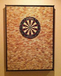 Cork backstop for a dart board - I like this but I'll have to drink a lot more wine to make it happen!  LOL!