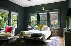 """Would need a few more """"solid"""" furniture pieces but love the general feel.  Little Green Notebook: Black Walls in Our Bedroom"""