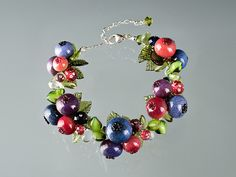 Fifteen Glass Blueberry Bracelet with Swarovski Elements crystals on Sterling Silver.   By Elizabeth Johnson.