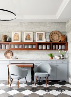 A Must-See Bright & Modern Kitchen Makeover | Designer Karen Cole brings warmth, light and style to a family kitchen with modern stone finishes and pops of wood and brass. Learn how she created a functional and elegant space by removing barriers and dividing the kitchen into zones, including a sit-in TV area and workspace. | http://houseandhome.com/tv/segment/must-see-bright-modern-kitchen-makeover