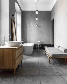 "Michelle Halford op Instagram: ""Today's Archive Series over on the blog thedesignchaser.com features favourite bathrooms All amazing, it's hard to pick one. Most have black accents (especially tapware) which I love, but this is still a standout. The grey palette, warm wood, freestanding bath, mirror and furniture (who wouldn't love a daybed in their bathroom?) Interior and furniture design by @loft.kolasinski by Karolina Bak #HouseNearBerlin #LoftKolasinski #TDCBlog #TDCArchiveSeries"""