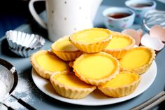 Freshly baked egg tarts with buttery base and soft egg custard insides.