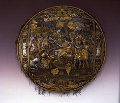 Schild / Garnitur bestehend aus Sturmhaube und Schild  Piccinino, Lucio (Plattner) Salamanca, Antonio (Vorlage) Cantona, Caterina (Seidensticker)  Mailand. Vor 1567.