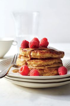 Fluffiest Multigrain Pancakes with Almond Butter Drizzle | Get ready; this will become your new Sunday morning staple. These pancakes are wonderfully hearty, thanks to old-fashioned oats and white whole-wheat flour, yet their texture is still fluffy and light, with a beguiling creaminess in the middle. Instead of dousing this short stack with syrup, we opt instead for a nutty sauce of maple-sweetened almond butter--cutting about 27g added sugars from the typical pancake breakfast.