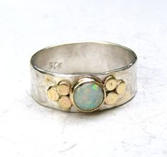Recycled silver sterling ring with Lovely white opal and 14k gold bazel and dots gold.    MADE TO ORDER IN ANY SIZE    This ring looks amazing when worn