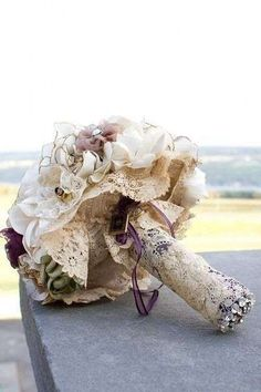 This bride took the lace from her mother's wedding dress and wrapped it around her bouquet. There are so many ways to incorporate your mom on your wedding day. This bouquet is. Lace Bouquet, Fabric Bouquet, Fabric Flowers, Bouquet Wrap, Lace Flowers, Boquet, Diy Bouquet, Homemade Bouquet, Bouquet Flowers