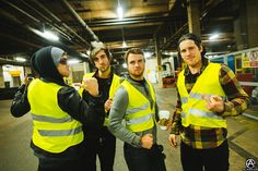 All Time Low in High Vis vests, you have to wear them in the parking garage in Manchester, UK. full set- http://adamelmakias.com/behind-the-scenes/photos-from-europe-uk-with-all-time-low/