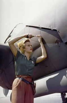 A female Lockheed engineer fixing a P-38 Lightning in 1944.