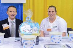 Mike Campbell (Platinum Productions) and Jennifer Cordio (North Middlesex Savings Bank) volunteer at the raffle table