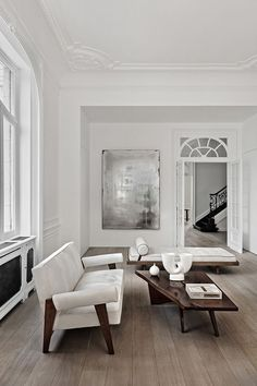 Minimal Contemporary Interior White oak floors white and wood accents neutral Joseph Dirand