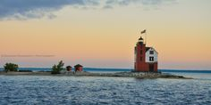 It may look more schoolhouse than lighthouse, but the Round Island Light—located in the Straits of Mackinac—shines as brightly today as it did when it was built in 1895. The original outhouse and oil house still stand.   - CountryLiving.com