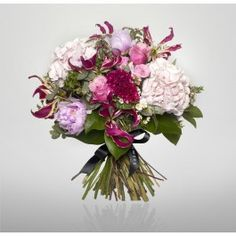 For something girly this pink and white bouquet of pink peonies, pink roses and pink hydrangeas alongside white gloriosa is perfect