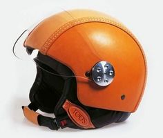 Tod's leather helmet Tod's leather  motorcycle helmet. Tod's Helmet was part of their product line expansion. This Motorcycle helmet is made of Tough Leather. Tod's leather helmet has a perfect vintage Helmet appeal. Tod's leather helmet has a protective visor and was made with iconic Vespa Scooter in mind. Tod's leather helmet  price £615.