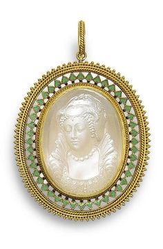 A gold, enamel and moonstone cameo pendant, by Carlo Giuliano, circa 1865 The oval moonstone cameo depicting an idealised portrait bust of Mary Queen of Scots, within a pierced gold frame of ropetwist and beaded decoration, with green enamel inverted heart motifs and black enamel dots.
