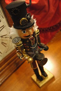 """Steampunk nutcracker. """"Started as a 'blank' wooden nutcracker and is now a steampunk gentleman complete with clockwork robotic arm and jetpack!"""" There are diy instructions on 'instructables' but it looks as though you have to pay for them. Also, there are more detailed pictures showing his jetpack, etc. OK I want this!"""