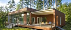 Modern loghouses by Sunhouse in Finland.